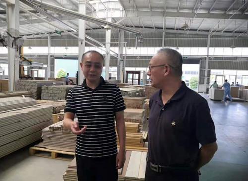 中国木材与木制品协会领导莅临千川木门视察调研